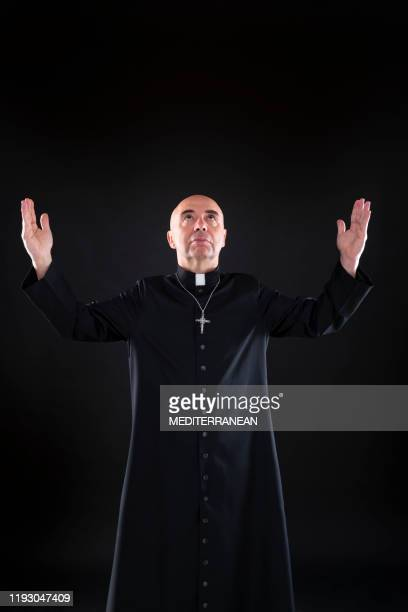 priest blessing praying god open hands with cassock - pastor stock pictures, royalty-free photos & images