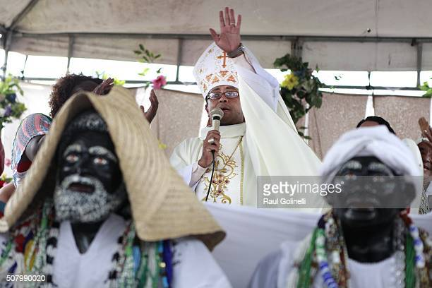 Priest blessing the faithful during service held at Rio Vermelho beach to celebrate Yemanja day on February 2 2016 in Salvador Brazil Yemanja is a...