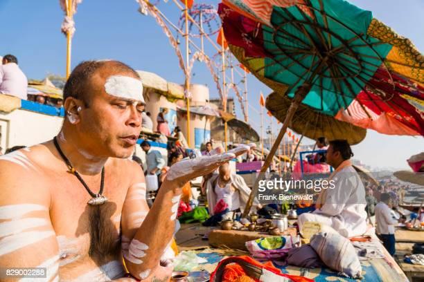 A priest Brahmin is performing a religious ritual at Dashashwamedh Ghat Main Ghat in the suburb Godowlia
