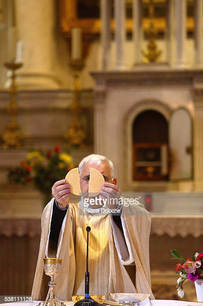 priest breaking communion wafer - sallanches stock pictures, royalty-free photos & images