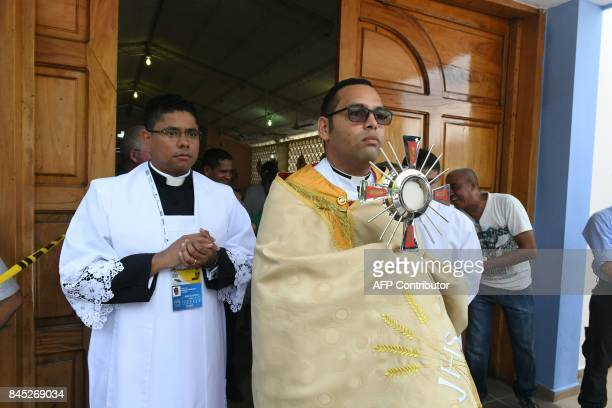 A priest carrying the monstrance holding the host waits for the arrival of Pope Francis on September 10 2017 at San Francisco Square in Cartagena...