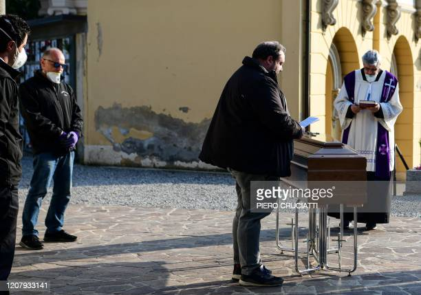 A priest celebrates funeral service without relatives inside the cemetery of Zogno near Bergamo northern Italy on March 21 2020 Italy on March 21...