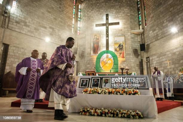 Priest celebrates the memorial service, on January 23 at the Consolata Shrine in Nairobi for six staff members of the Dusit hotel and office complex...