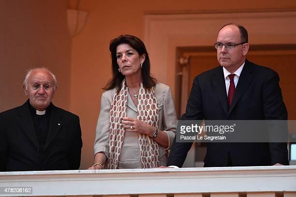 Priest Cesar Penzo Princess Caroline of Hanover and Prince Albert II of Monaco attend the 'Fete de la St Jean' procession on June 24 2015 in Monaco...