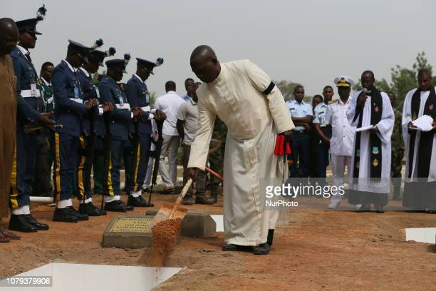 A priest conducts funeral service for the the remains of five officers who died in the helicopter crash in Damasak in Abuja Nigeria on January 8th...