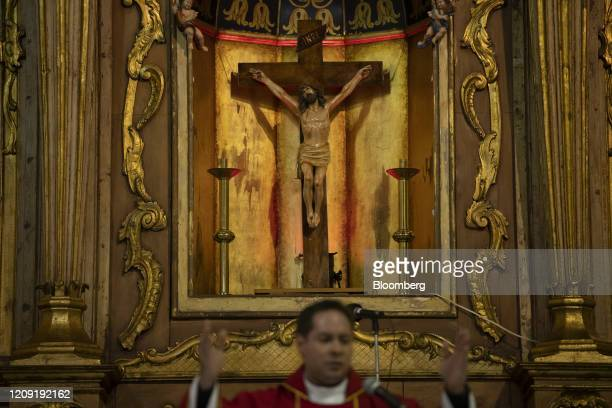 A priest delivers a Palm Sunday mass in Caracas Venezuela on Sunday April 5 2020 Amid the coronavirus as the world's major religions enter one of the...
