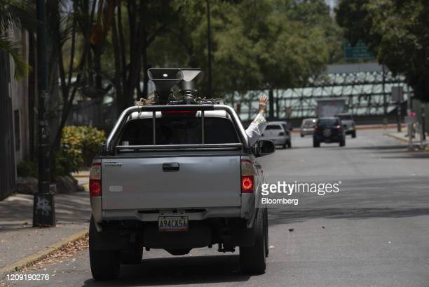 A priest delivers blessings from a vehicle during Palm Sunday in Caracas Venezuela on Sunday April 5 2020 Amid the coronavirus as the world's major...
