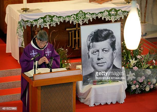 Priest Eiji Tanaka leads a mass in honour of former US president John F. Kennedy on the 50th anniversary of his assassination at his San-no Cho...