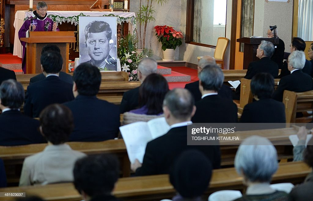 Priest Eiji Tanaka (top L) leads the mass in honour of former US president John F. Kennedy on the 50th anniversary of his assassination at his San-no Cho Catholic Toyama church in Toyama on November 23, 2013. About 100 followers in different religions gathered to mourn the late US president.
