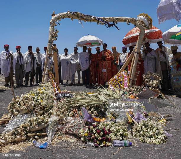 Priest from the Ethiopian Orthodox Church pray and sing during the Asrahhullet or Tulluferra ceremony on March 21 2019 in Ejere Ethiopia In the...