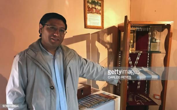 A priest gestures at the museum of the Virgin of Copacabana del Abra de Punta Corral in 'Nuesta Senora del Rosario' parish church in Tilcara Jujuy...