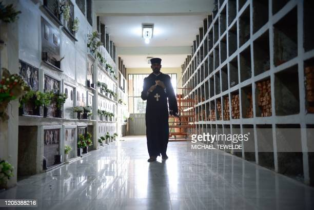 Priest Hadis Aba Tsegazeab stands at a memorial site as he offers prayers for victims of the Ethiopian Airlines Flight 302 crash at Trinity Cathedral...