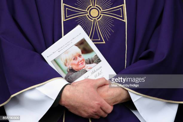 A priest holds an order of service during the funeral of Liz Dawn at Salford Cathedral on October 6 2017 in Salford England Actress Liz Dawn played...
