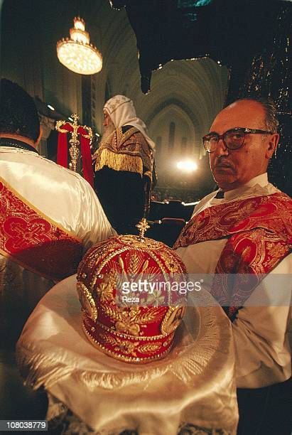 A priest holds on a cushion the Pope Chenouda III's tiara during the Coptic Christmas ceremony celebrated in the Cathedral of St Mark in Cairo on the...