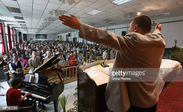 A priest hosts a communion service at a church on July 3 2005 in Xining of Qinghai Province northwest China China officially sanctions five religious...