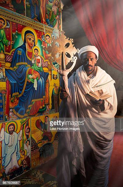 priest in an orthodox monastery, lalibela, ethiopia - lalibela stock photos and pictures