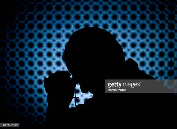 priest in confession booth with cross - catholicism stock pictures, royalty-free photos & images
