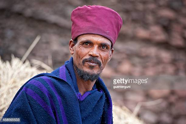 priest in front of a rock hewn church, lalibela, ethiopia - orthodox church stock pictures, royalty-free photos & images
