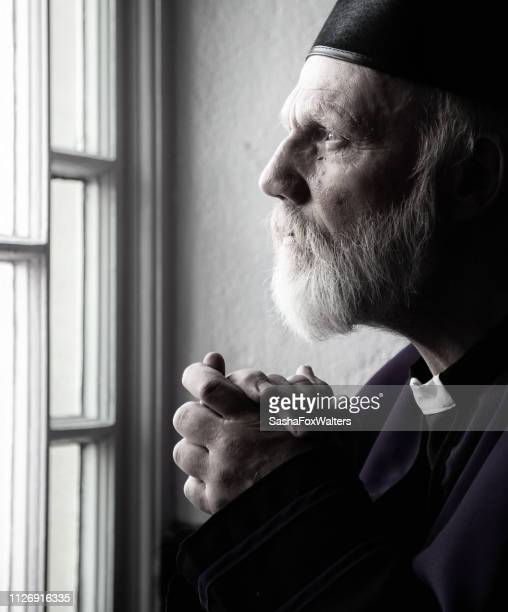 priest in prayer - orthodox church stock pictures, royalty-free photos & images