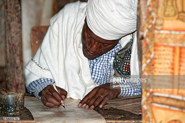 priest is handwriting, lalibela, ethiopia - orthodox church stock pictures, royalty-free photos & images