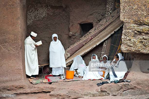 priest is reading for pilgrims, lalibela, ethiopia - orthodox church stock pictures, royalty-free photos & images