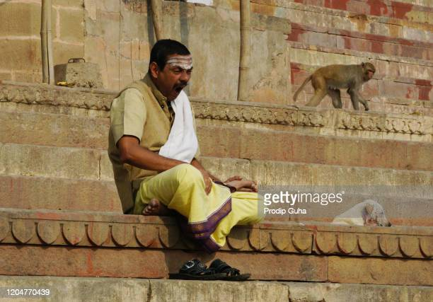 Priest is seated at Dasaswamedh ghat on the edge of Ganges river on February 04, 2020 in Varanasi, India.