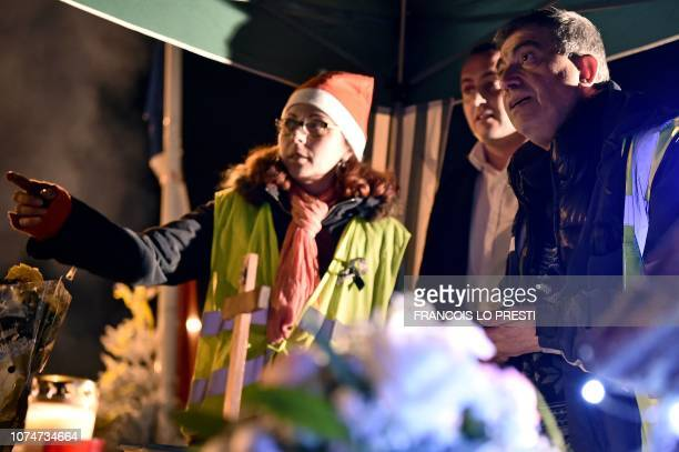 Priest Joseph Nurchi prepares for a Christmas mass for yellow vests protestors near a roundabout in Somain northern France where they spend Christmas...