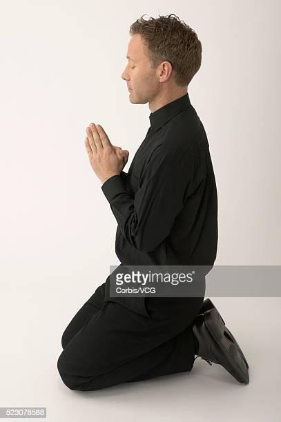Priest Kneeling and Praying