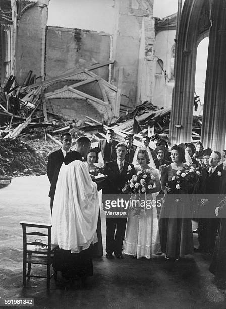 A priest leading a wedding ceremony amongst the ruins of a bombed church as life goes on as normal during the blitz In London October 1940