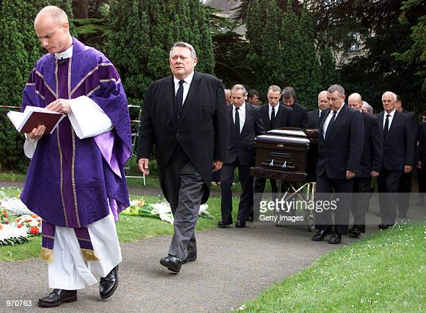 A priest leads the funeral procession to St Edwards Church for John Entwistle's funeral service July 10 2002 in StowontheWold United Kingdom...