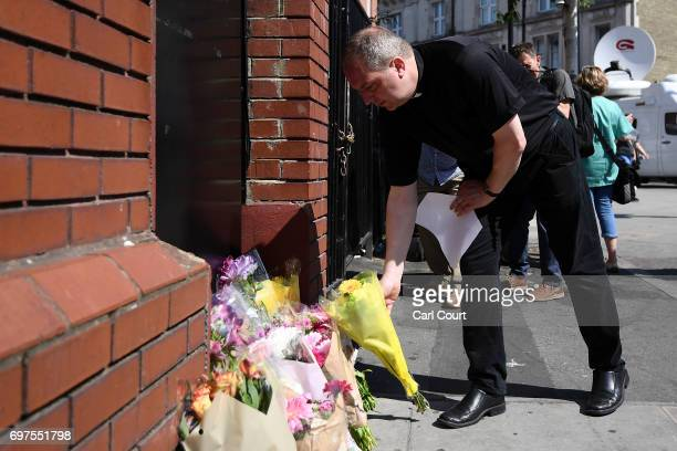 A priest leaves flowers at the scene of a terror attack in Finsbury Park in the early hours of this morning on June 19 2017 in London England...