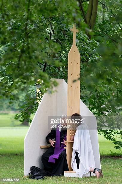 A priest listens to a confession on the first day of the World Youth Days in Krakow on July 26 Pope Francis heads to Poland Wednesday for an...