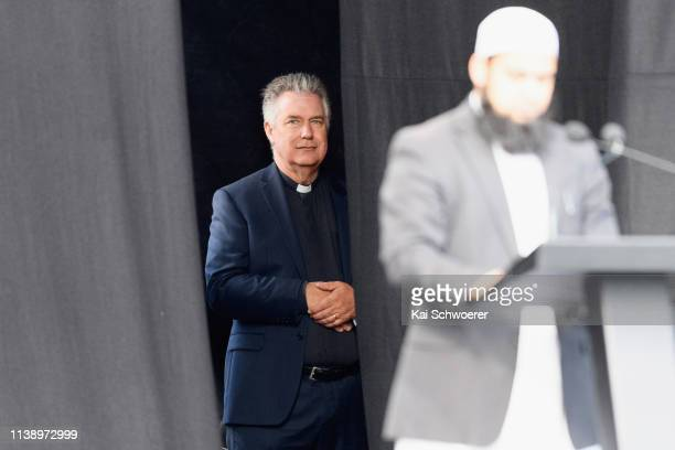 A priest looks on as Shaggaf Khan President of the Muslim Association of Canterbury speaks during the National Remembrance Service on March 29 2019...