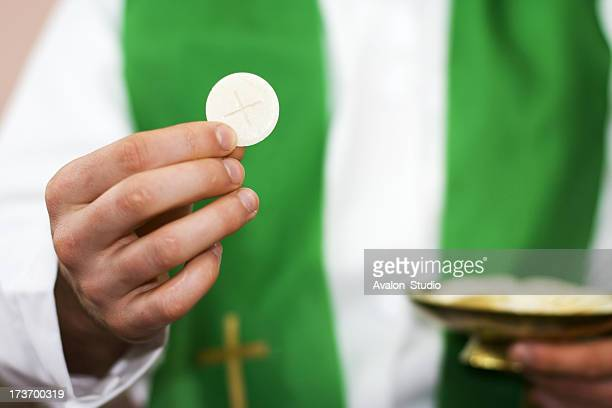 Priest of communion in the hand