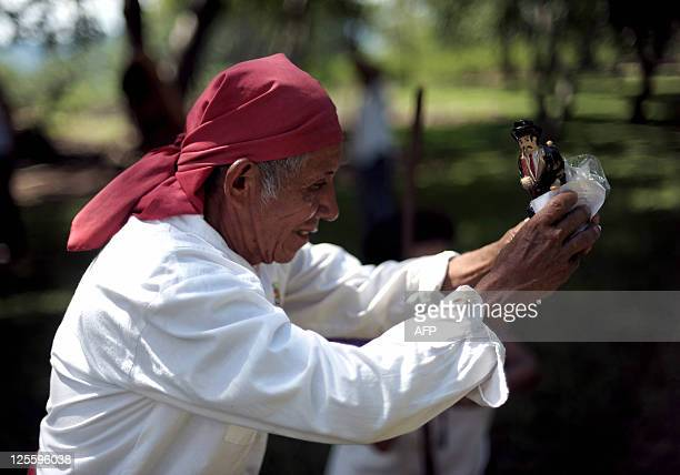 A priest of the Nahua Pipil ethnic group prepares an image of San Simon a pagan divinity during a ceremony to celebrate the autumn solstice in the...