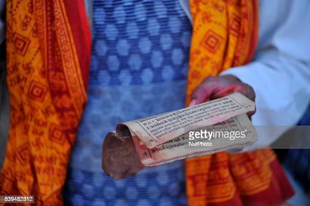A Priest offering ritual prayer at the Bank of Bagmati River of Pashupatinath Temple during Rishi Panchami Festival celebrations at Pashupatinath...