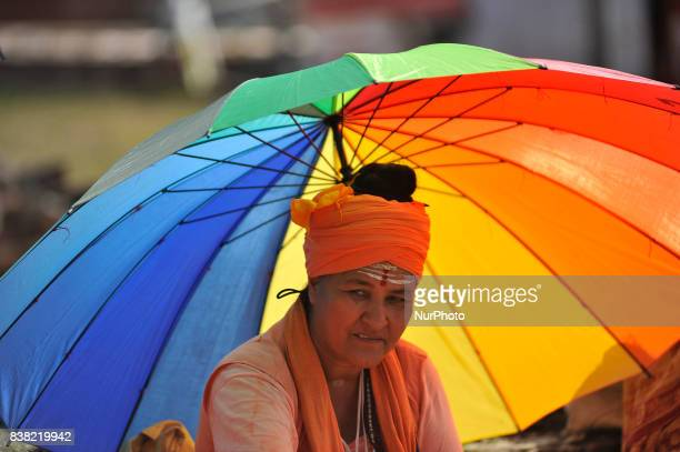 A priest offering ritual prayer during Teej festival celebrations at Pashupatinath Temple Kathmandu Nepal on Thursday August 24 2017 The Teej...