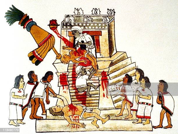 Priest offering the heart taken from a living human victim to the Aztec sun god and god of war Huitzilopochtli Print of facsimile from Aztec Codex...