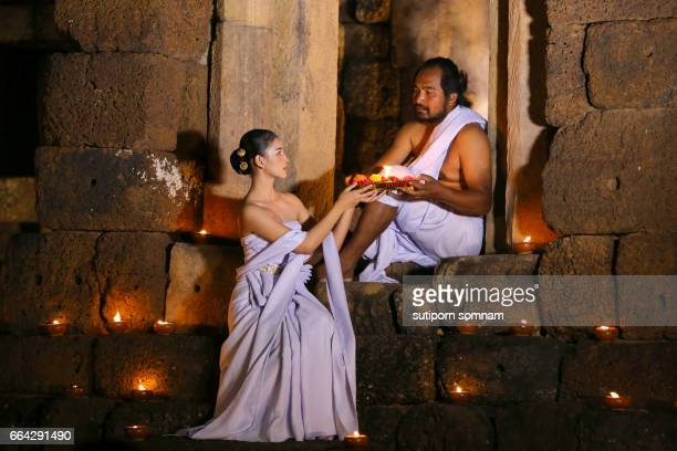 Priest or Yogi and  Woman priest are Religious ceremony in  Ancient ornate huts made