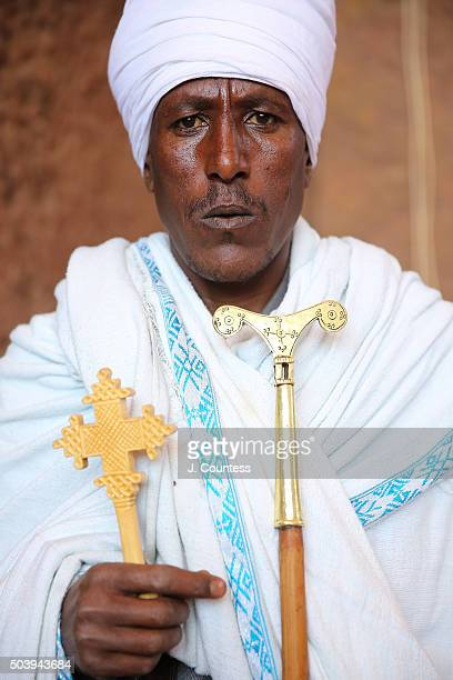 A priest outside of Beta Mariam Church on January 7 2016 in Lalibela Ethiopia Thousands of adhearants to the Ethiopian Orthodox Faith descend upon...
