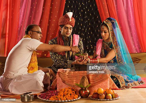 Priest performing religious ceremony in wedding mandap
