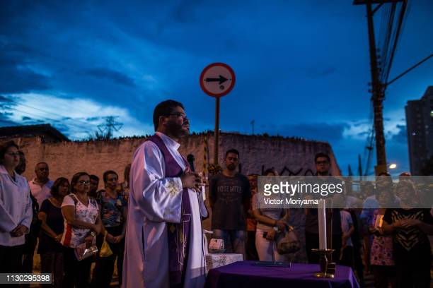 Priest performs an ecumenical act among family and friends in honor of those killed in the Raul Brasil School shooting in which two young men shot...