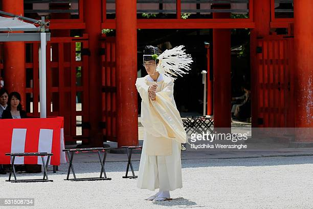 A priest performs ritual ceremony during the Aoi Festival at Shimogamo Shrine on May 152016 in Kyoto Japan Aoi Festival is one of the three main...