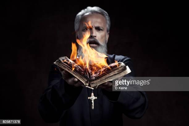 priest - osterfeuer stock-fotos und bilder