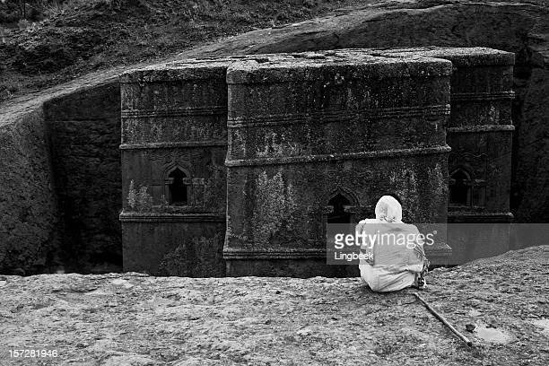 priest praying in lalibela b&w bet giorgis - ethiopian orthodox church stock pictures, royalty-free photos & images