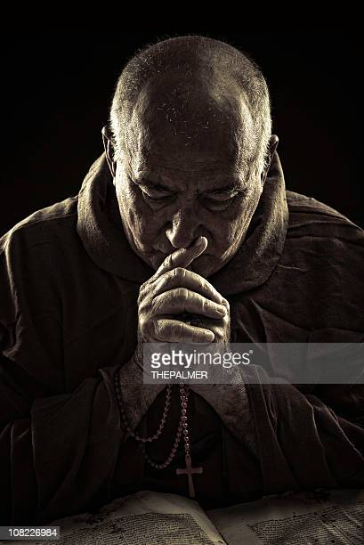 priest praying