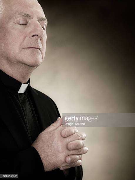 a priest praying - priest stock pictures, royalty-free photos & images