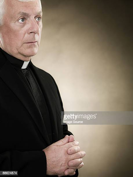 A priest praying