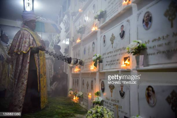 A Priest prays at the Cemetery of victims of Ethiopian Airlines Flight 302 during the commemoration of the first year anniversary at the Holy Trinity...