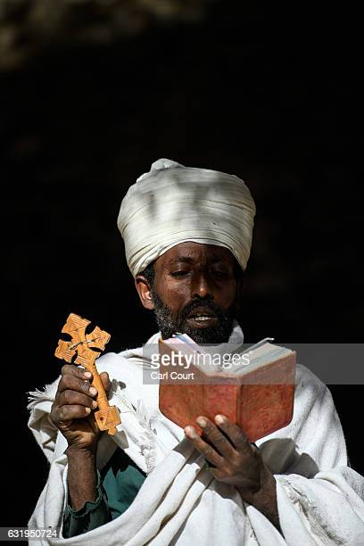 A priest prays in the grounds of a church as Timkat celebrations get under way on January 18 2017 in Gondar Ethiopia Timkat is the Ethiopian Orthodox...
